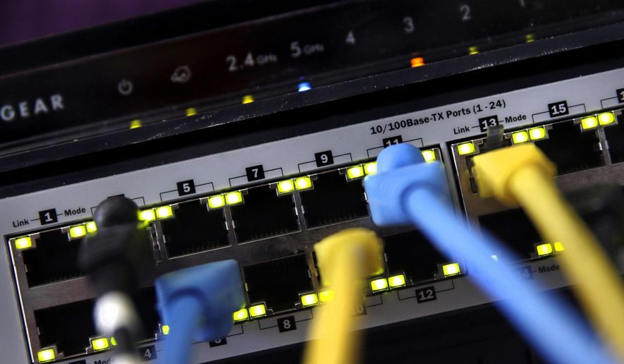 In this June 19, 2018, file photo, a router and internet switch are displayed in East Derry, N.H. The FBI said cyberattacks have become common at schools, which are attractive targets because they hold sensitive data and provide critical public services. Malicious use of the data could lead to bullying, tracking and identity theft, the agency said. (AP Photo/Charles Krupa, File)