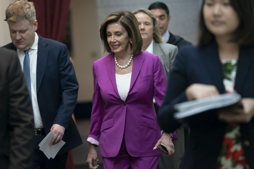 """House Speaker Nancy Pelosi, D-Calif., arrives for a closed-door session with her caucus before a vote on a resolution condemning what she called """"racist comments"""" by President Donald Trump at the Capitol in Washington, Tuesday, July 16, 2019. His remarks were directed at Reps. Ilhan Omar of Minnesota, Alexandria Ocasio-Cortez of New York, Ayanna Pressley of Massachusetts and Rashida Tlaib of Michigan. (AP Photo/J. Scott Applewhite)"""