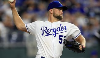 Kansas City Royals starting pitcher Glenn Sparkman delivers to a Chicago White Sox batter during the ninth inning of a baseball game at Kauffman Stadium in Kansas City, Mo., Tuesday, July 16, 2019. Sparkman threw a five-hitter as the Royals won 11-0. (AP Photo/Orlin Wagner)