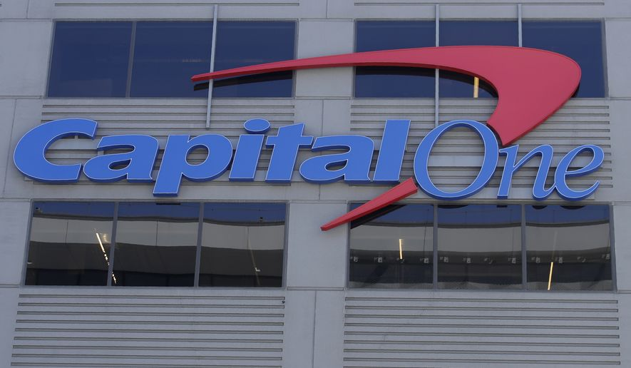 A Capital One sign is shown at a location in San Francisco, Tuesday, July 16, 2019. (AP Photo/Jeff Chiu)