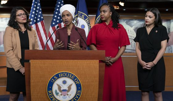 In this Monday, July 15, 2019, file photo, U.S. Rep. Ilhan Omar, D-Minn, second from left, speaks, as U.S. Reps., from left, Rashida Tlaib, D-Mich.,Ayanna Pressley, D-Mass., and Alexandria Ocasio-Cortez, D-N.Y., listen, during a news conference at the Capitol in Washington. (AP Photo/J. Scott Applewhite, File)