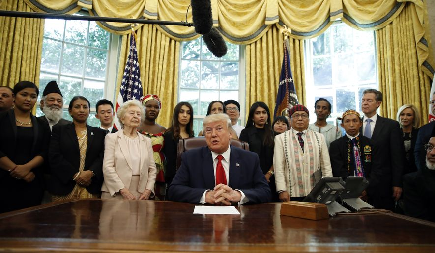 President Donald Trump speaks as he meets with survivors of religious persecution in the Oval Office of the White House on Wednesday, July 17, 2019, in Washington. The survivors come from countries including, Myanmar, New Zealand, Yemen, China, Cuba, Eritrea, Nigeria, Turkey, Vietnam, Sudan, Iraq, Afghanistan, North Korea, Sri Lanka, Pakistan, Iran and Germany.(AP Photo/Alex Brandon)