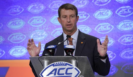 Clemson head coach Dabo Swinney speaks during the Atlantic Coast Conference NCAA college football media day in Charlotte, N.C., Wednesday, July 17, 2019. (AP Photo/Chuck Burton) **FILE**