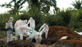 In this photograph taken Sunday July 14, 2019, an Ebola victim is put to rest at the Muslim cemetery in Beni, Congo DRC. The head of the World Health Organization is convening a meeting of experts Wednesday July 17, 2019 to decide whether the Ebola outbreak should be declared an international emergency after spreading to eastern Congo's biggest city, Goma, this week. More than 1,600 people in eastern Congo have died as the virus has spread in areas too dangerous for health teams to access. (AP Photo/Jerome Delay)