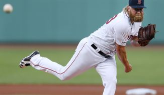 Boston Red Sox's Andrew Cashner pitches during the first inning of the team's baseball game against the Toronto Blue Jays in Boston, Tuesday, July 16, 2019. (AP Photo/Michael Dwyer)