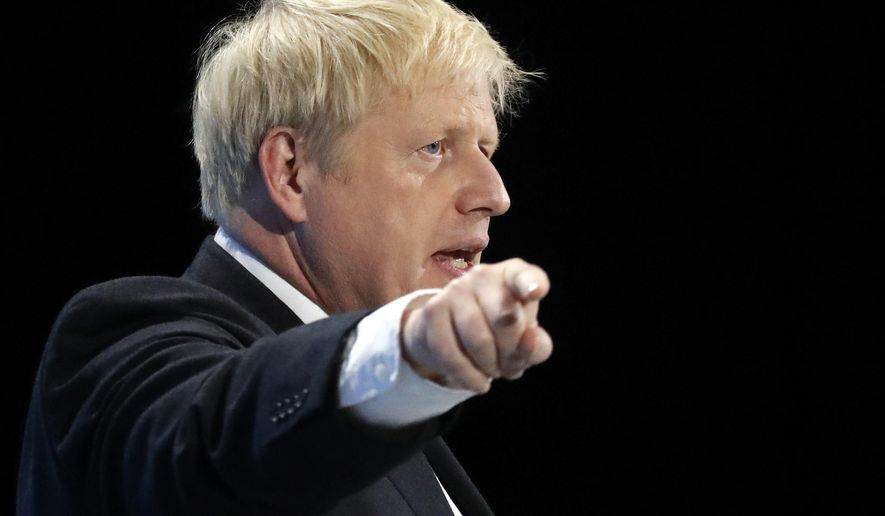 Conservative party leadership candidate Boris Johnson delivers his speech during a Conservative leadership hustings at ExCel Centre in London, Wednesday, July 17, 2019. The two contenders, Jeremy Hunt and Boris Johnson are competing for votes from party members, with the winner replacing Prime Minister Theresa May as party leader and Prime Minister of Britain's ruling Conservative Party. (AP Photo/Frank Augstein)