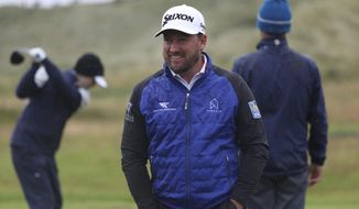 Northern Ireland's Graeme McDowell smiles on the practice range ahead of the start of the British Open golf championships at Royal Portrush in Northern Ireland, Wednesday, July 17, 2019. The British Open starts Thursday. (AP Photo/Jon Super)