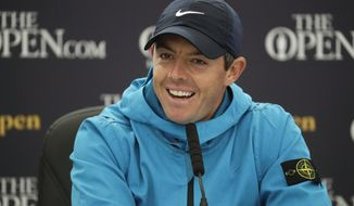 Northern Ireland's Rory McIlroy smiles as he listens to a question from the media at a press conference ahead of the start of the British Open golf championships at Royal Portrush in Northern Ireland, Wednesday, July 17, 2019. The British Open starts Thursday. (AP Photo/Matt Dunham)