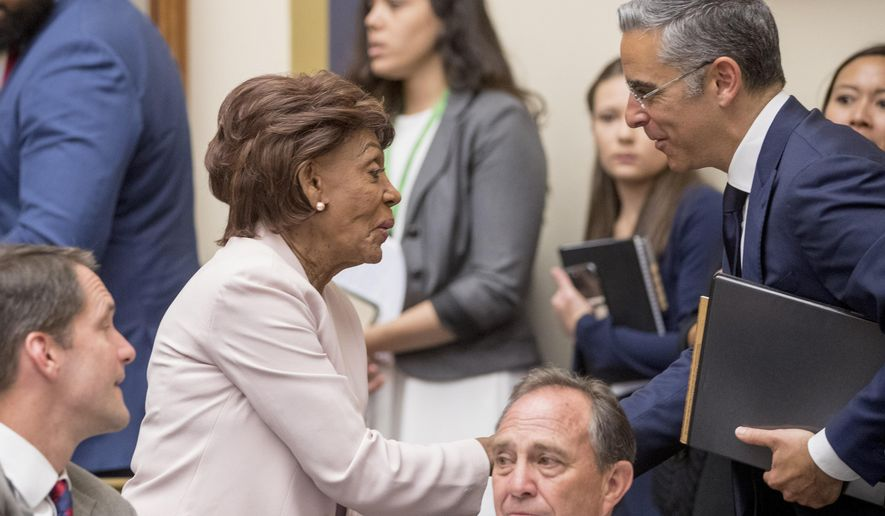 Chairwoman Rep. Maxine Waters, D-Calif., left, and David Marcus, CEO of Facebook's Calibra digital wallet service, speak during a hearing break while Marcus appears before a House Financial Services Committee hearing on Facebook's proposed cryptocurrency on Capitol Hill in Washington, Wednesday, July 17, 2019. (AP Photo/Andrew Harnik)