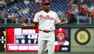 Philadelphia Phillies relief pitcher Hector Neris reacts after he was ejected for hitting Los Angeles Dodgers' David Freese with a pitch during the ninth inning of a baseball game Tuesday, July 16, 2019, in Philadelphia. Philadelphia won 9-8. (AP Photo/Matt Slocum)