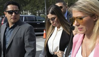 """Emma Coronel Aispuro, center, wife of Mexican drug lord Joaquin """"El Chapo"""" Guzman, arrives for his sentencing at Brooklyn federal court, Wednesday, July 17, 2019 in New York. The 62-year-old Guzman was convicted in February on multiple conspiracy counts in an epic drug-trafficking case. (AP Photo/Mark Lennihan)"""