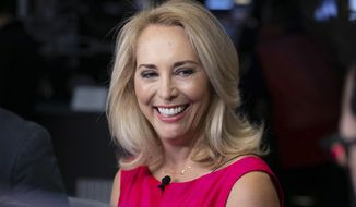 FILE - In this Oct. 22, 2018, file photo, former CIA operative Valerie Plame is interviewed on the floor of the New York Stock Exchange. Thousands of small campaign contributions from undisclosed sources have propelled Plame to the financial pole position in a crowded primary competition for an open northern New Mexico congressional seat in 2020. Plame spokesman Daniel Garcia says that thousands of small contributions to the campaign since April 1, 2019, are evidence of broad political support from everyday people. (AP Photo/Richard Drew, File)