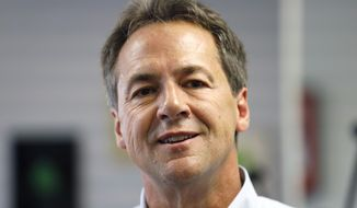 Democratic presidential candidate Montana Gov. Steve Bullock speaks to reporters after touring the POET Biorefining facility, Tuesday, July 9, 2019, in Gowrie, Iowa. (AP Photo/Charlie Neibergall)