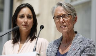 Junior Minister of Ecological and Inclusive Transition Brune Poirson, left, listens to new Ecology Minister Elisabeth Borne during the handover ceremony at the ecology ministry, Wednesday, July 17, 2019 in Paris. Francois de Rugy resigned Tuesday following media reports that he has been living a lavish lifestyle at taxpayer expense, including hosting lobster and Champagne soirees and ordering up exorbitant renovations of his ministerial apartment. (AP Photo/Kamil Zihnioglu)