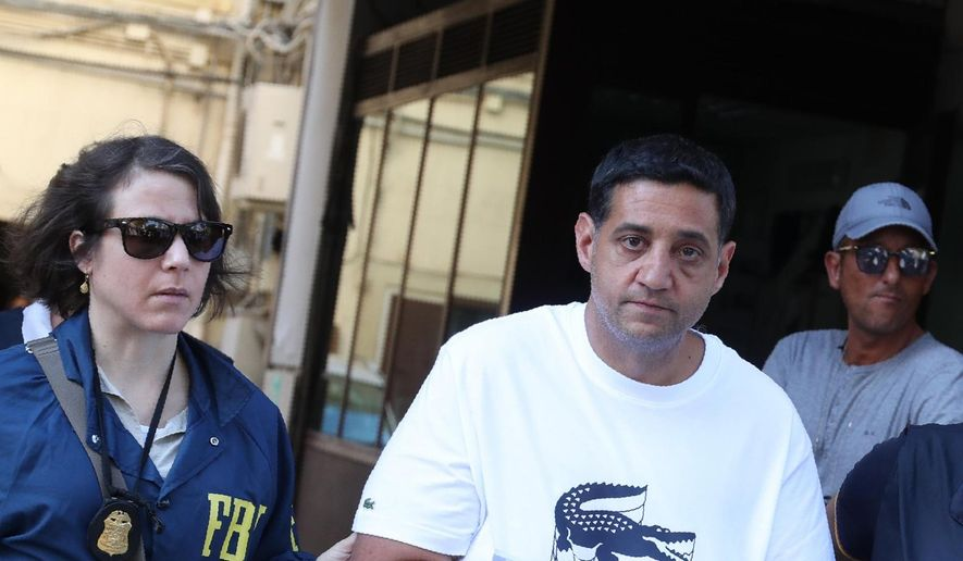 Suspect Thomas Gambino, right, is taken into custody during an anti-mafia operation lead by the Italian Police and the FBI in Palermo, Southern Italy, Wednesday, July 17, 2019. Italian police and the FBI arrested 19 suspected Mafiosi in a joint operation Wednesday following an investigation which revealed alleged ties between Sicily's Cosa Nostra Mafia and New York's Gambino crime family. (Igor Petix/ANSA Via AP)