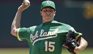 Oakland Athletics pitcher Homer Bailey works against the Seattle Mariners in the first inning of a baseball game Wednesday, July 17, 2019, in Oakland, Calif. (AP Photo/Ben Margot)
