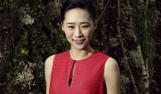In this May 21, 2019, photo actress Wu Ke-xi poses for portrait photographs at the 72nd international film festival, Cannes, southern France. Wu Ke-xi wrote a screenplay inspired by the scandal involving U.S. producer Harvey Weinstein. The #MeToo movement in entertainment isn't just an American phenomenon. Cases across Asia show the region is grappling with many of the same issues that have upended entertainment careers in the U.S.(Photo by Joel C Ryan/Invision/AP)