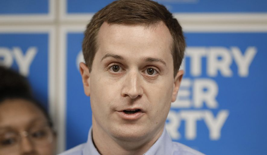 In this May 15, 2019, file photo, Dan McCready, a 9th Congressional District Democratic candidate, answers a question during a news conference in Charlotte, N.C. (AP Photo/Chuck Burton, File)