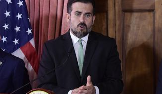 Puerto Rico Gov. Ricardo Rossello speaks during a press conference in La Fortaleza's Tea Room, in San Juan, Puerto Rico, Tuesday, July 16, 2019. Rossello summoned the press a few hours after a riot took place near the executive mansion, where protesters demanded Rossello step down after a leak of profanity-laced and at times misogynistic online chat with nine other male members of his administration. (AP Photo/Carlos Giusti)