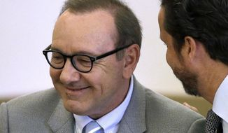 In this June 3, 2019, file photo, actor Kevin Spacey listens to attorney Alan Jackson during a pretrial hearing at district court in Nantucket, Mass. On Wednesday, July 17, prosecutors dropped the sexual assault case against Oscar-winning actor, who had been accused of groping 18-year-old man in 2016 in the crowded bar at the Club Car in Nantucket. (AP Photo/Steven Senne, File)