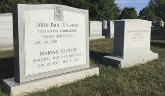 The headstone for retired Supreme Court Justice John Paul Stevens is seen, Wednesday, July 17, 2019 at Arlington National Cemetery in Arlington, VA. Arlington National Cemetery has known for years that it would be the final resting place of retired Supreme Court Justice John Paul Stevens, who died Tuesday at age 99. His second wife Maryan died in 2015 and was buried at the cemetery, and the gravestone they will share has stood at Arlington, inscribed with both their names, since then.   (AP Photo/Jessica Gresko)