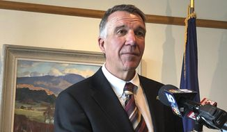 """Vermont Republican Gov. Phil Scott, speaking at a news conference in Montpelier, Vt., on Wednesday July 17, 2019, said he thought President Donald Trump's comments about four Democratic congresswomen of color were """"offensive"""" and """"racist."""" Scott said """"words matter and we've seen this same rhetoric used throughout history to discriminate, degrade and divide."""" (AP Photo/Wilson Ring)"""