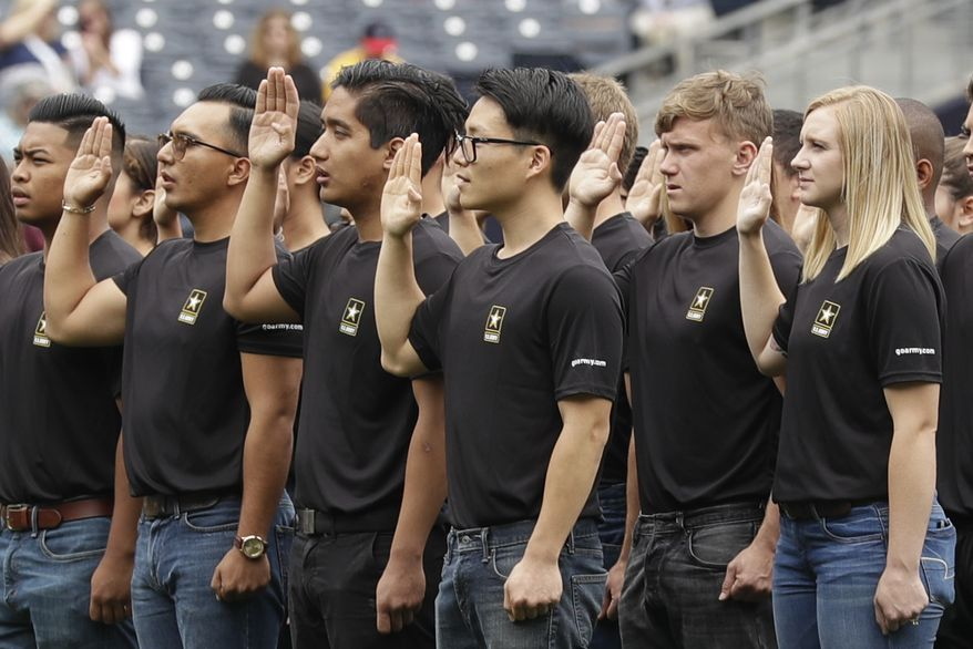 In this June 4, 2017, file photo. nNew Army recruits take part in a swearing in ceremony before a baseball game between the San Diego Padres and the Colorado Rockies in San Diego. The Army has missed its recruiting goal for the first time in more than a decade. Army leaders tell The Associated Press they signed up about 70,000 new troops for the fiscal year that ends Sept. 30, 2018. (AP Photo/Gregory Bull, File)