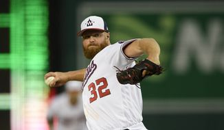 Washington Nationals relief pitcher Aaron Barrett delivers a pitch during an exhibition baseball game against the New York Yankees, Monday, March 25, 2019, in Washington. (AP Photo/Nick Wass) **FILE**
