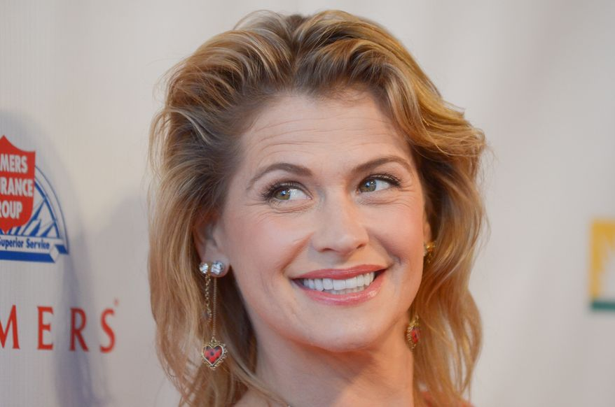 Kristy Swanson arrives at the American Red Cross 7th Annual Red Tie Affair at the  Fairmont Miramar Hotel on Saturday, April 6, 2013 in Los Angeles. (Photo by Richard Shotwell/Invision/AP)