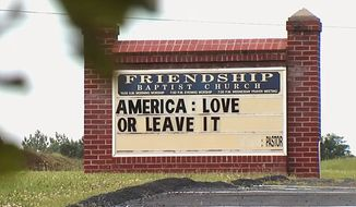 """This image taken from video provided by WSET-TV shows a sign """"America: Love it or Leave It."""" posted outside the Friendship Baptist Church in Appomattox, Va., on Tuesday, July 16, 2019.    Amid a national furor over President Donald Trumps tweet urging four Democratic congresswomen to go back to their home countries,  Pastor E. W. Lucas is gaining attention with the sign at his church  (WSET-TV via AP) . MANDATORY CREDIT   LYNCHBURG AND ROANOKE OUT"""