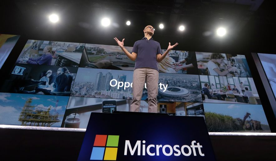 In this May 6, 2019, file photo Microsoft CEO Satya Nadella delivers the keynote address at Build, the company's annual conference for software developers in Seattle. Microsoft Corp. reports earnings Thursday, July 18, 2019. (AP Photo/Elaine Thompson, File)