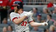 Washington Nationals pitcher Stephen Strasburg follows through on a single during the third inning of the team's baseball game against the Atlanta Braves on Thursday, July 18, 2019, in Atlanta. (AP Photo/John Bazemore)
