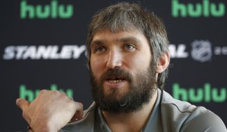 In this May 27, 2018, file photo, Washington Capitals left wing Alex Ovechkin speaks during an NHL hockey media day in Las Vegas. Capitals captain Alex Ovechkin will go to China as part of the NHLs continued outreach in that country. Ovechkin will visit Beijing in early August as a league ambassador. Hes expected to take part in youth hockey clinics, interviews and business development meetings. (AP Photo/John Locher, FIle)