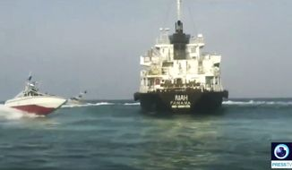 This undated photo provided by Iranian state television's English-language service, Press TV, shows the Panamanian-flagged oil tanker MT Riah surrounded by Iranian Revolutionary Guard vessels. Iran said Thursday, July 18, 2019, that its Revolutionary Guard seized a foreign oil tanker and its crew of 12 for smuggling fuel out of the country. The Riah, which had disappeared off trackers in Iranian territorial waters over the weekend, stopped transmitting its location early Sunday near Irans Qeshm Island, according to data listed on tracking site Maritime Traffic. (Press TV via AP)