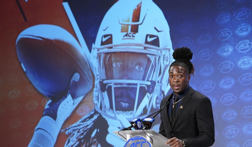 Virginia's Bryce Perkins speaks during the Atlantic Coast Conference NCAA college football media days in Charlotte, N.C., Thursday, July 18, 2019. (AP Photo/Chuck Burton) **FILE**