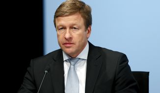 FILE - In this March 21, 2018, file photo member of the board of the German car manufacturer BMW, Oliver Zipse, attends the earnings press conference in Munich, Germany. On Thursday, July 18, 2019, BMW named its top production manager, Zipse, as its next CEO to lead the luxury automaker. (AP Photo/Matthias Schrader, File)