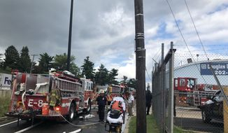 D.C. Fire and Emergency Medical Services personnel responding to a bus garage fire in Northeast Washington, D.C., on July 17, 2019. (Moss Brennan/The Washington Times)