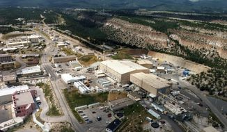 FILE - This undated file aerial view shows the Los Alamos National Laboratory in Los Alamos, N.M. An economic impact report released Thursday, July 18, 2019, shows the lab contributed more than $3 billion a year to New Mexico's economy through federal funding and spending by employees and vendors. (Albuquerque Journal/The Albuquerque Journal via AP)