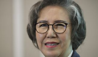 """U.N. Special Rapporteur for Human Rights in Myanmar, Lee Yanghee, smiles during a press conference in Kuala Lumpur, Thursday, July 18, 2019. U.N. envoy Lee said the U.S. didn't """"go far enough"""" in sanctions against four top Myanmar generals over the mass killings of Rohingya Muslims. (AP Photo/Vincent Thian)"""