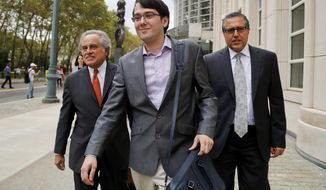 FILE - In this Thursday, July 27, 2017, file photo, Martin Shkreli, center, leaves federal court with his attorney Benjamin Brafman, left, in New York. A federal appeals court on Thursday, July 18, 2019 has upheld the securities fraud conviction against the former drug company CEO. (AP Photo/Julie Jacobson, File)