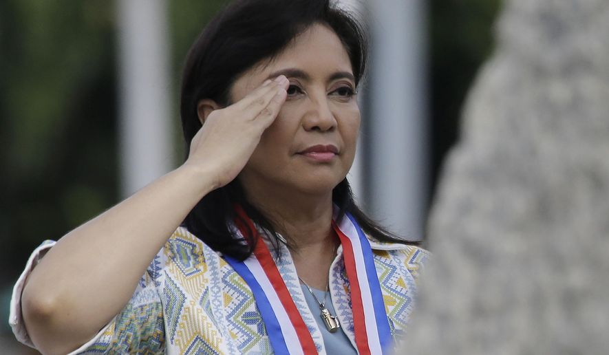 FILE - In this June 12, 2019 file photo, Philippine Vice President Leni Robredo salutes during a wreath-laying ceremony to mark the 121st anniversary of Philippine independence at Manila's Rizal Park, Philippines. Officials say police have filed sedition and other criminal complaints against the vice president, three opposition senators, four Roman Catholic bishops and a university president for allegedly conniving to destabilize President Rodrigo Duterte's administration. (AP Photo/Aaron Favila)