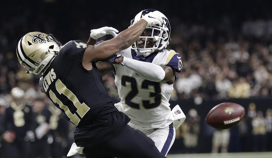 "In this Jan. 20, 2019, file photo, Los Angeles Rams' Nickell Robey-Coleman breaks up a pass intended for New Orleans Saints' Tommylee Lewis during the second half of the NFL football NFC championship game in New Orleans. A Louisiana judge won't stop a lawsuit against the NFL over the playoff ""no-call"" that led to the Rams defeating the Saints and advancing to the 2019 Super Bowl. State Civil District Court Judge Nicole Sheppard ruled Thursday, July 18, 2019 in the damage suit filed by attorney Antonio LeMon. (AP Photo/Gerald Herbert, File) **FILE**"