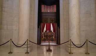 The doors to the Supreme Court are draped in black in honor of retired Associate Justice John Paul Stevens who died this week at age 99, at the Supreme Court in Washington, Wednesday, July 17, 2019. Stevens served on the high court for almost 35 years. (AP Photo/J. Scott Applewhite)