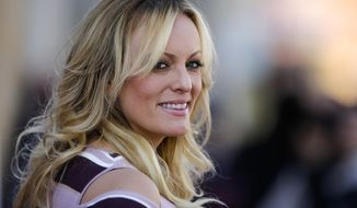 In this Oct. 11, 2018, file photo, adult film actress Stormy Daniels attends the opening of the adult entertainment fair 'Venus' in Berlin, Germany. Search warrants unsealed Thursday, Jul 18, 2019, shed new light on President Donald Trump's role as his campaign scrambled to respond to media inquiries about hush money paid to two women who said they had affairs with him. The investigation involved payments Trump's attorney Michael Cohen helped orchestrate to Daniels and Playboy centerfold Karen McDougal. (AP Photo/Markus Schreiber, File)