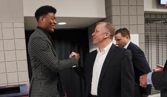Washington Wizards first round draft pick Rui Hachimura, left, shakes hands with Wizards senior vice president of basketball operations Tommy Sheppard as they arrive for an NBA basketball press conference at Capital One Arena in Washington, Friday, June 21, 2019.(AP Photo/Pablo Martinez Monsivais)**FILE****
