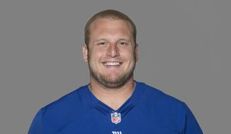 This 2012 file photo, shows Mitch Petrus of the New York Giants NFL football team. Officials say Petrus, a former Arkansas offensive lineman who later won a Super Bowl with the New York Giants, has died in Arkansas of apparent heat stroke. He was 32. (AP Photo/File)