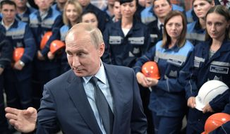 Russian President Vladimir Putin gestures while speaking to workers as he visits the Magnitogorsk Iron and Steel Works company in Magnitogorsk, Russia, Friday, July 19, 2019. (Alexei Nikolsky, Sputnik, Kremlin Pool Photo via AP)