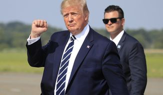 President Donald Trump waves as he walks from Air Force One upon arrival at Morristown Municipal Airport, in Morristown, N.J., Friday, July 19, 2019. (AP Photo/Manuel Balce Ceneta)