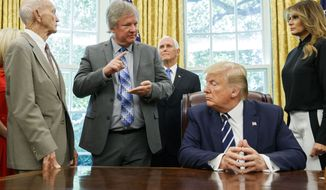 "President Donald Trump, accompanied by Apollo 11 astronaut Micheal Collins, left, Eric ""Rick"" Armstrong, son of Neil Armstrong, second from left, with Vice President Mike Pence and first lady Melania Trump, listens during a photo opportunity commemorating the 50th anniversary of the Apollo 11 moon landing, in the Oval Office of the White House, Friday, July 19, 2019, in Washington. (AP Photo/Alex Brandon)"