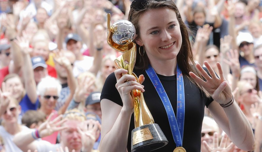 U.S. women's soccer team player Rose Lavelle holds her trophy as she attends a welcome event in her honor at Fountain Square, Friday, July 19, 2019, in Cincinnati. The U.S. national team beat the Netherlands 2-0 to capture a record fourth Women's World Cup title. Lavelle scored the second goal for the U.S. in the victory. (AP Photo/John Minchillo) ** FILE **